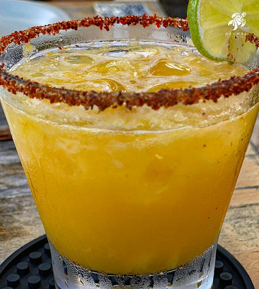 A yummy mango margarita with a chili lime salt edge
