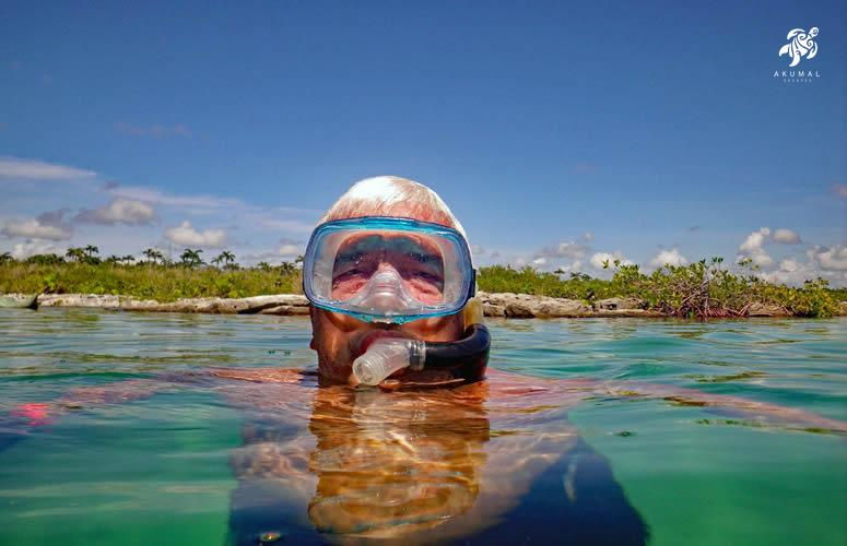 The calm waters of Akumal's bays make excellent fish and turtle viewing, wearing a snorkel mask