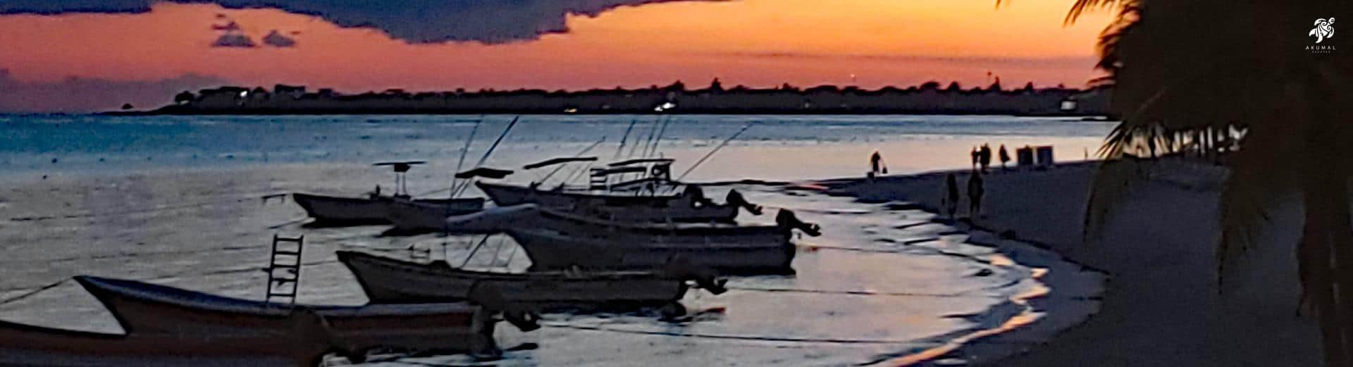 Akumals' sunsets are consistantly picture worthy, such as this one showing local fishing boats
