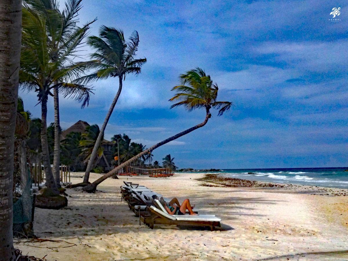 People lounging on another beautiful Riviera Maya beach, this one near Tulum