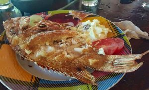 Fresh fried bocaneta with better and garlic