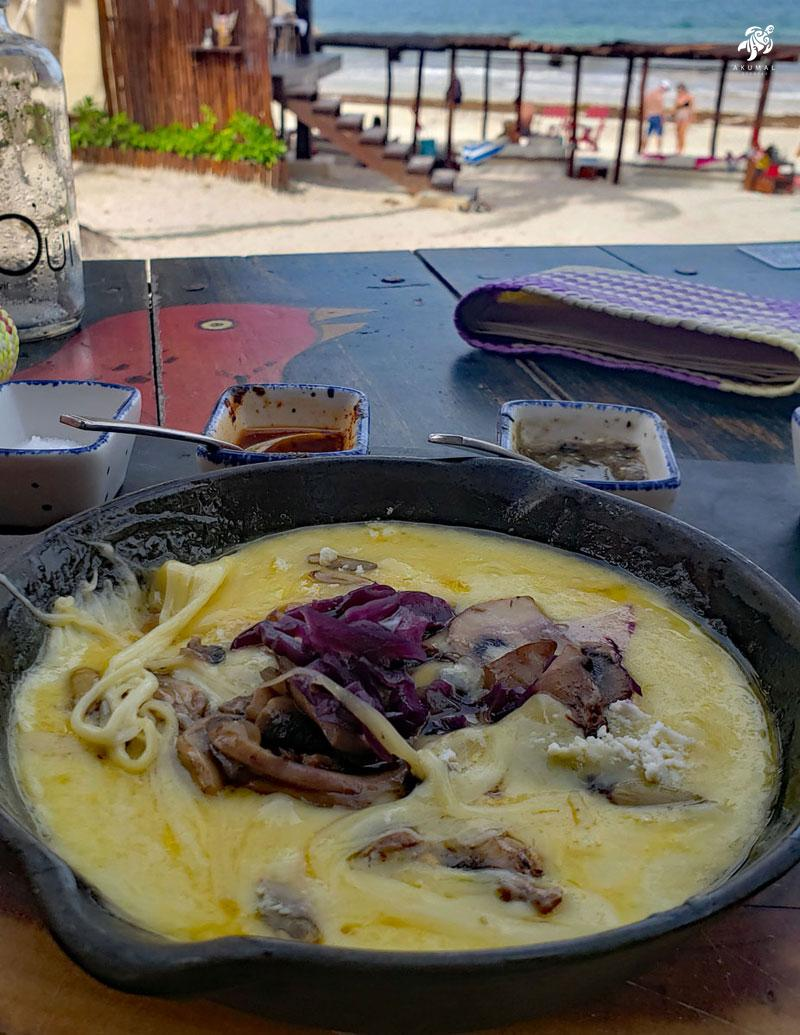 Queso fundito with chorizo by the beach
