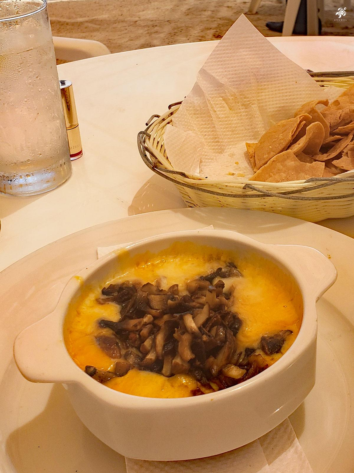 Queso fundito (melted mexican cheese) with mushrooms