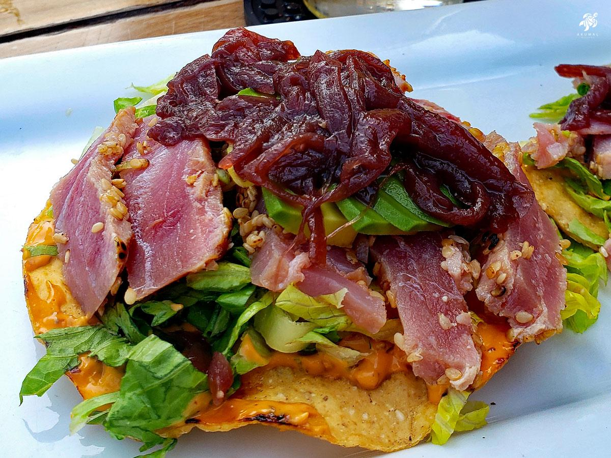 A tuna tostada with red onion jam