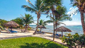 Looking from the lawn area towards the sand area on La Sirena's beach