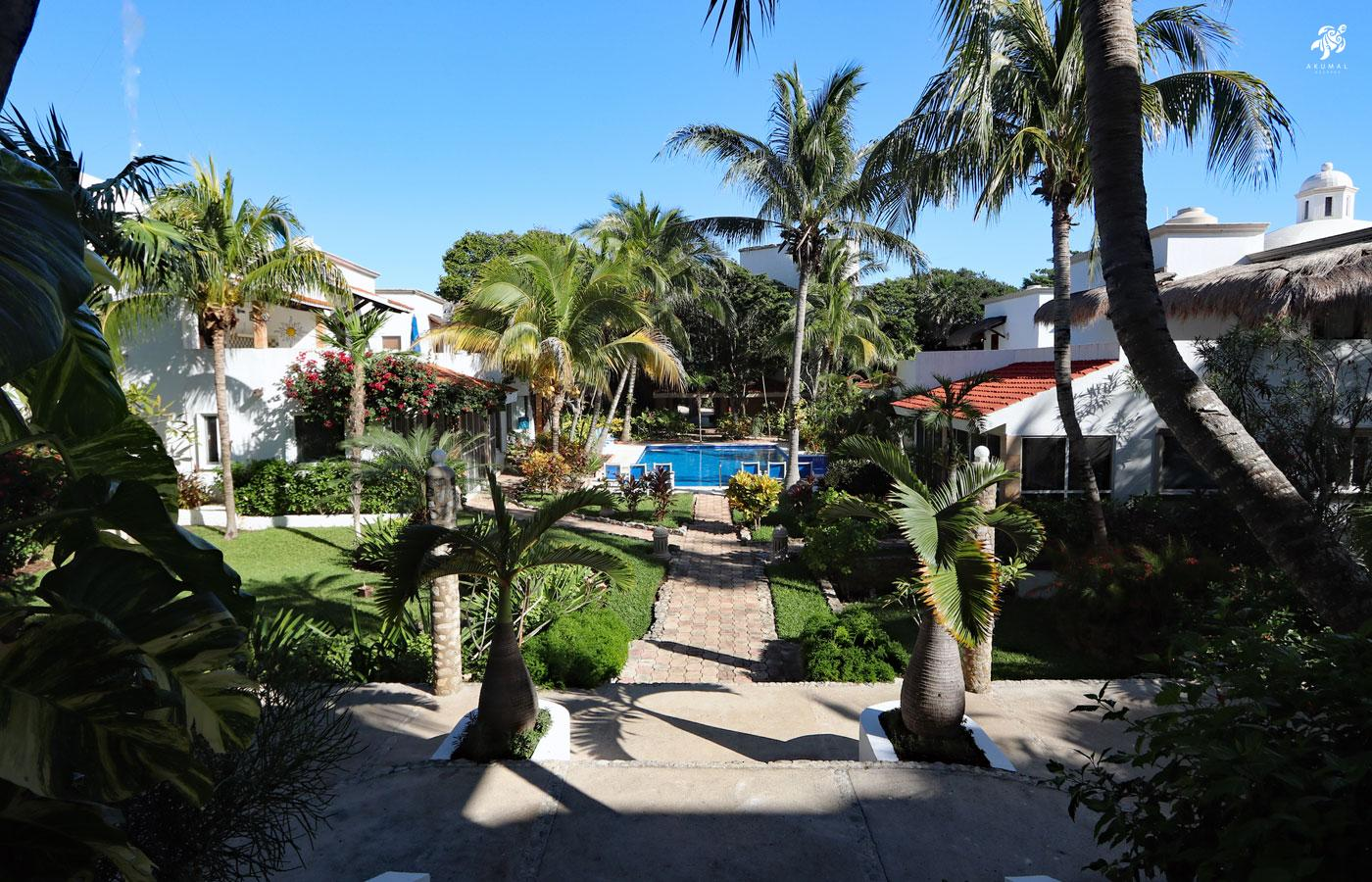 Looking from the beach paseo to our gardens and pool