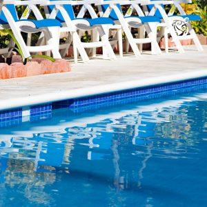 A fun photo of the pools water and pool chairs