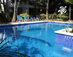 Another beautiful pool view towards a seating area