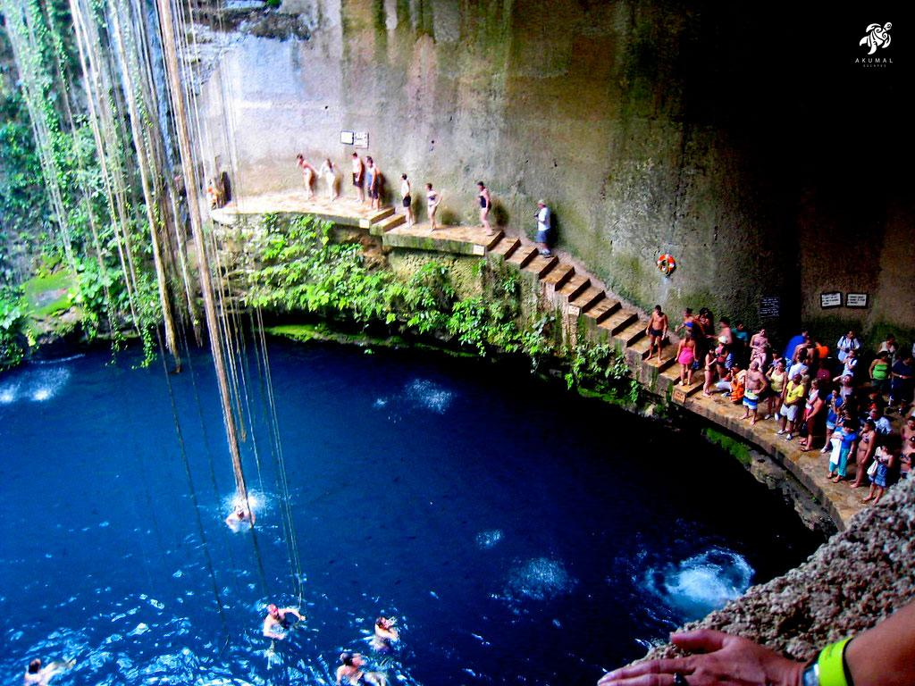 Swimmers getting ready to jump into a huge cenote!