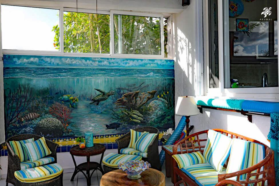 Seascape, La Sirena 1: The beach porch has great seating and a handpainted mural of Half Moon Bay underwater Caribbean.