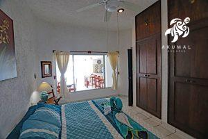 Tranquility, La Sirena #8, The master bedroom with it's king sized bed has a window towards the living area and beach