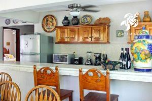 Villa Jardin, La Sirena #16, the kitchen's large long bar overlooks the kitchen makes for fun entertaining chef viewing!