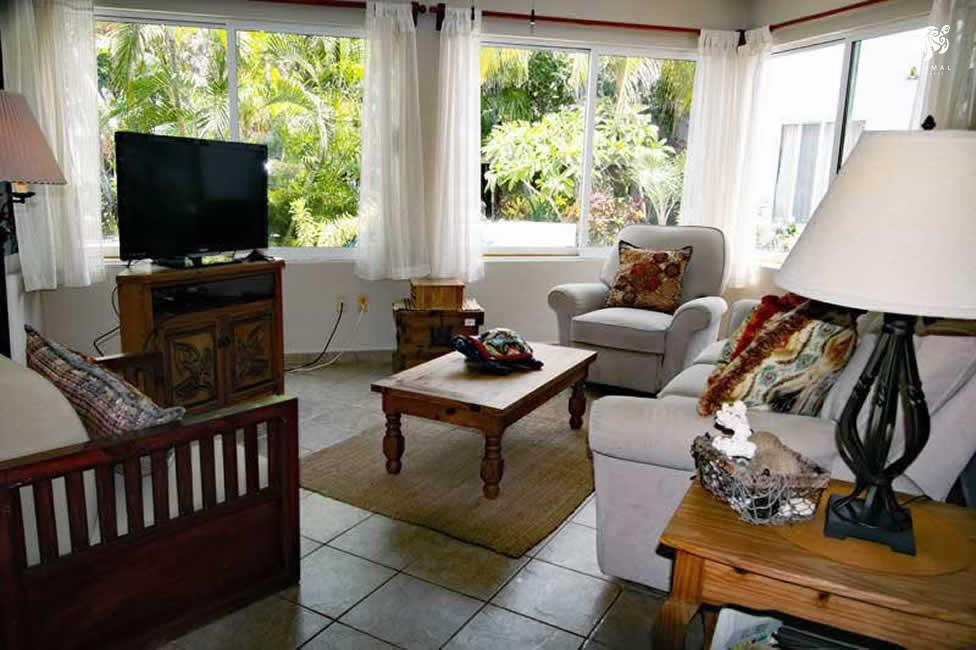 Villa Jardin, La Sirena #16, the living room with its super comfy recliner and soft couch and giant TV