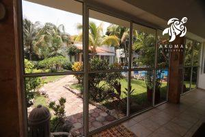 Villa Jardin, La Sirena #16, The view from the downstairs porch of the pool and magical tropical gardens