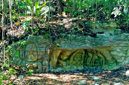 Mayan ruins and depictions are everywhere, like this one by the side of the road