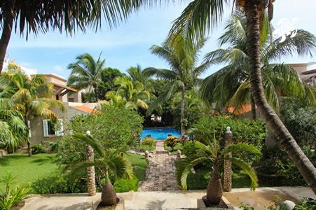 A view from the beach paseo to La Sirena's gardens and pool shows the spaciousness of our private property