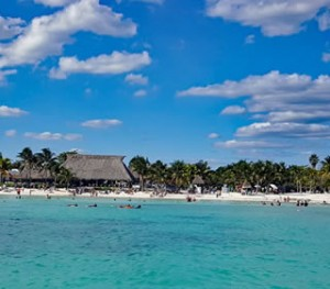Akumal Bay from the water: caribbean blue and snorkelers