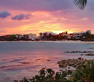 The purples, pinks and yellows of Akumal's sunsets as seen from La Sirena's beach