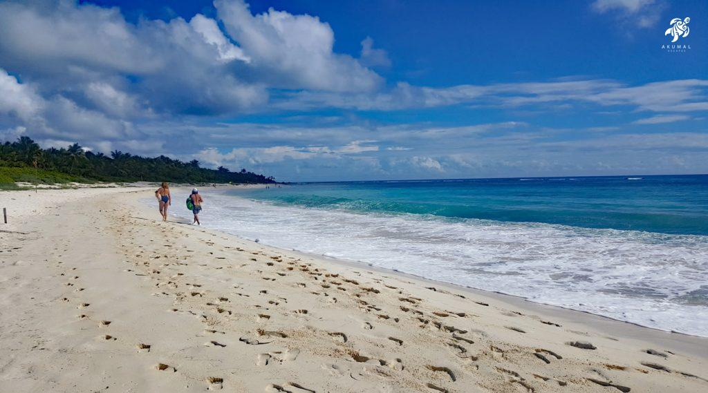 Footsteps in the sand on a quiet Mayan Riviera beach