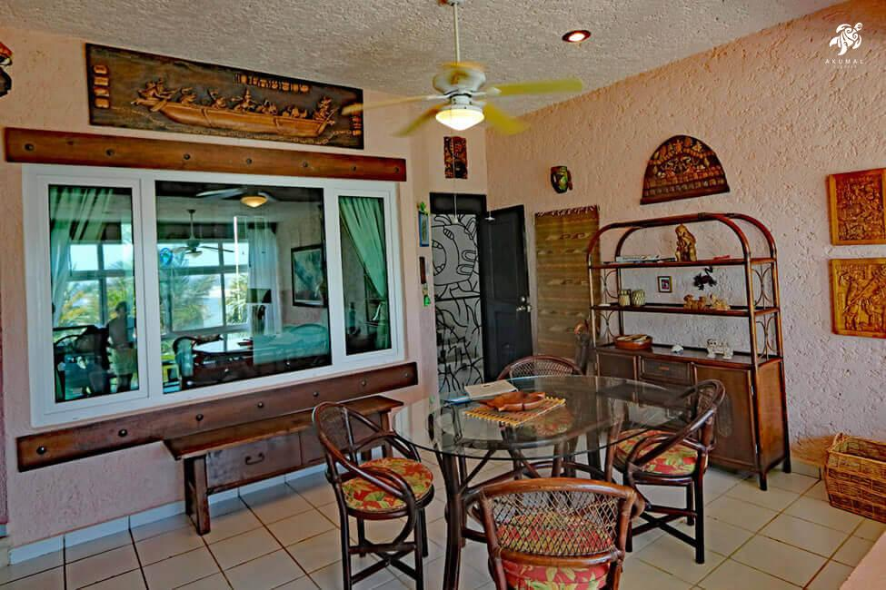 Cen Balam, La Sirena #5, Looking towards the dining room with its incredible artwork and jaguar decorative iron screen door