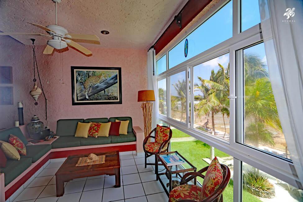 Cen Balam, La Sirena #5, Sunlight streams through the living room's floor to ceiling windows creating stunning views