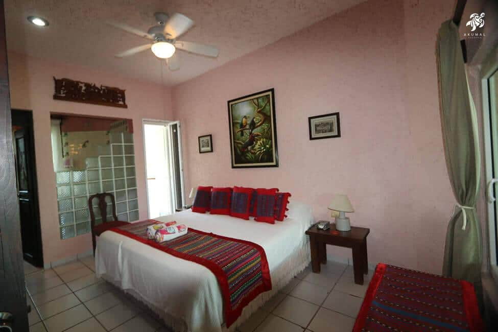 Cen Balam, La Sirena #5, The master bedroom is decorated with local and vintage art and Guatamalen linens on the king bed