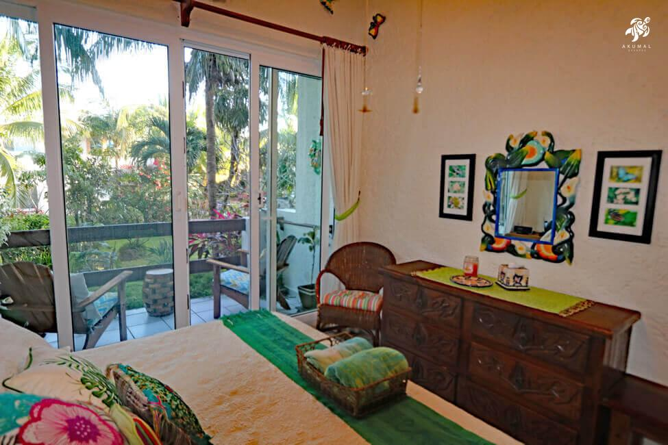 Seascape, La Sirena 1: The 2nd bedroom done in a butterfly motif has it's a private porch overlooking La Sirena's gardens