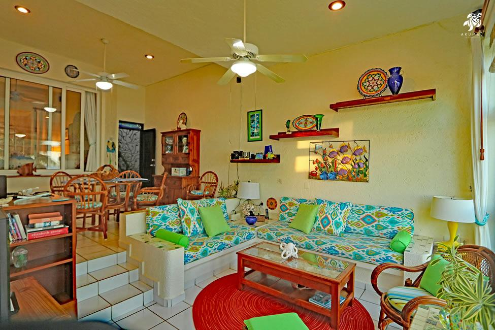 Seascape, La Sirena 1: The main living and dining areas done in a bright contemporry Caribbean theme