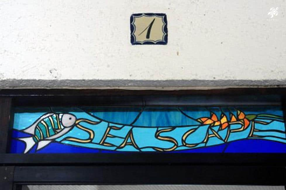 Seascape, La Sirena 1: Seascape's Name in Custom Stained Glass at It's Entrance