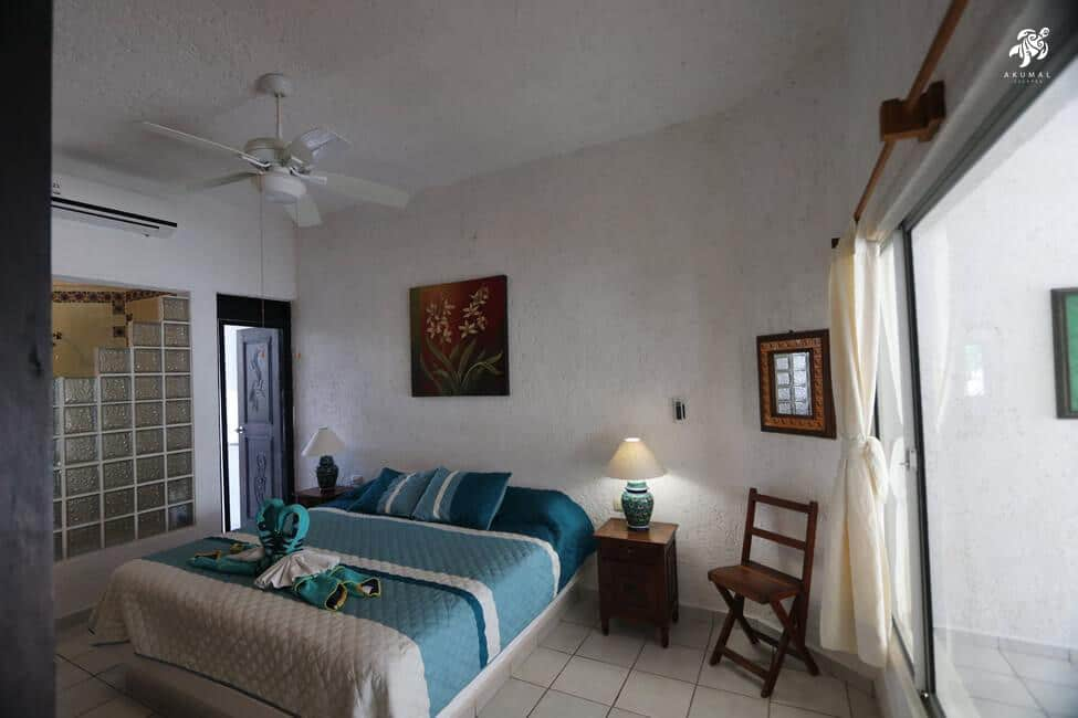 Tranquility, La Sirena #8, The master bedroom has a king bed en-suite bath and private garden porch