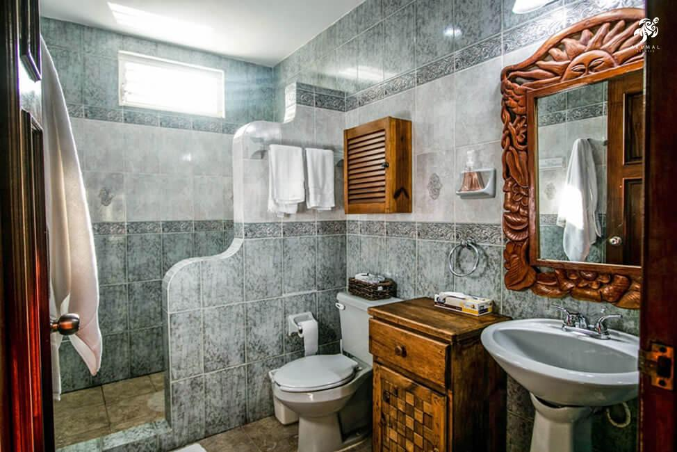 Villa Jardin, La Sirena #16, the downstairs bath has a large shower and sink area and is fully tiled in soothing aqua
