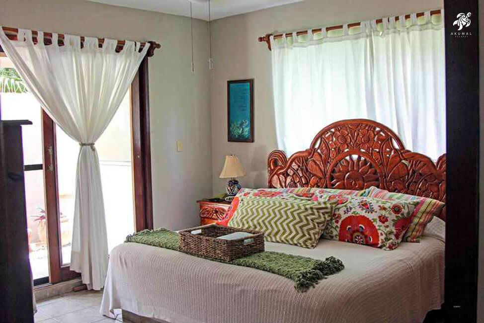 Villa Jardin, La Sirena #16, the dowstairs king has custom linens and looks to a small private garden
