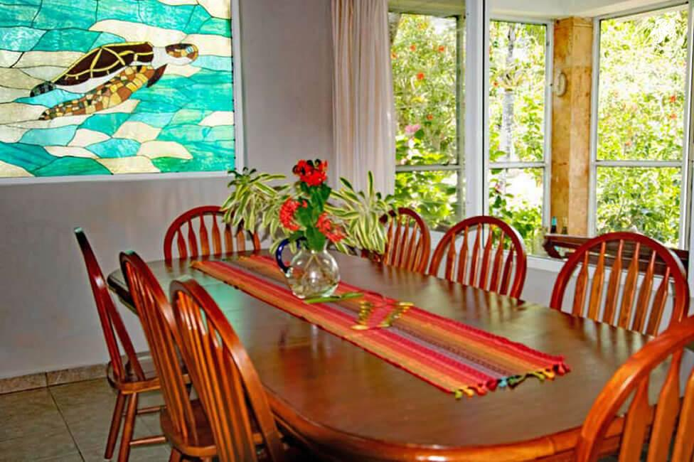 Villa Jardin, La Sirena #16, the dining room with it's large shaker style table and chairs has great garden views