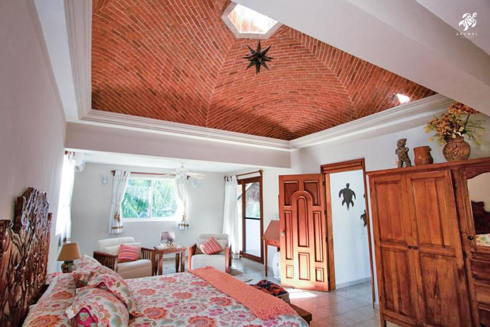 Villa Jardin, La Sirena #16, the upstairs master bedroom boasts a ceiling cupola with transomes centered with a Mayan star