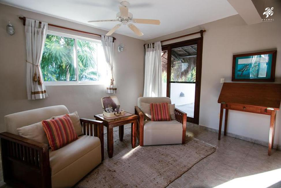 Villa Jardin, La Sirena #16, the upstairs master bedroom sitting area has comfortable lounge chairs and a writing desk