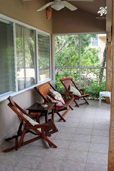 Villa Jardin, La Sirena #16, the screened in entry porch with natural seating for enjoying the gardens up close